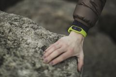 Person Wearing Yellow Fitness Band Holding Rock stock image