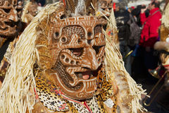 Person wears a carnival costume and mask at Lucern Carnival in Lucerne, Switzerland. Royalty Free Stock Photo