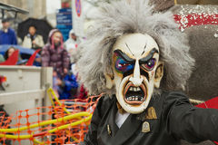 Person wears carnival mask at Basel Carnival in Basel, Switzerland. Stock Photo