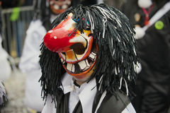 Person wears Waggis mask at Basel Carnival in Basel, Switzerland. Royalty Free Stock Photography