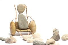 A person on wheelchair. A person is sitting on wheelchair and little stones Royalty Free Stock Photos