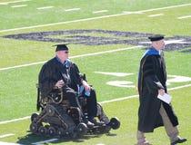 Person in wheelchair, Graduation, Northwestern Oklahoma State University. May 6, 2017, graduation commencement on the football field in Alva, Oklahoma. Educators Stock Photo