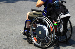 Disabled Wheelchair. Disabled on wheelchair moving on road Stock Photography