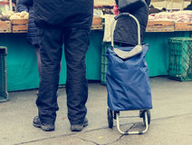 Person with wheeled shopping bag. Stock Images