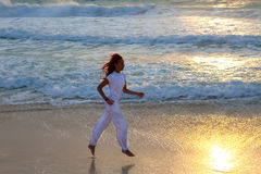The person in white clothes near a bright spot of light Stock Photography