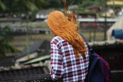 Person in White and Red Checkered Top With Black and Red Backpack in Shallow Focus Photography royalty free stock photography