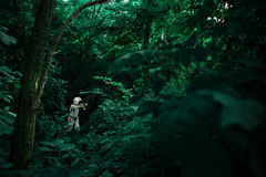 Person in White Suit With Helmet in Forest Stock Image