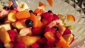 Fruit salad an a bowl. A person who eats the healthy fruit salad stock footage