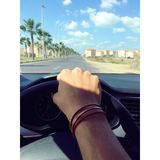 Person Withe Bracelets Holding Black Steering Wheel Royalty Free Stock Photography