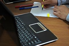 A person work on desk. Stock Photo