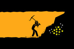 Person worker digging and mining for gold in an underground tunnel. Stock Image