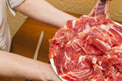 Person working. Person, cut ham,person serving a plate of jamon, person working Royalty Free Stock Photos