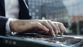 Person working on laptop at the Park near office. Hands Closeup stock video