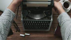Person working on old typewriter. Cropped shot of man typing on typewriter at his workplace stock video