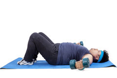 Person workout on mat with dumbbells Stock Photo