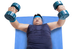 Person workout by weightlifting Royalty Free Stock Image