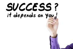 Person write success depends on you Stock Images
