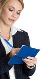 Person Writing Check. Beautiful business person writing check Royalty Free Stock Images