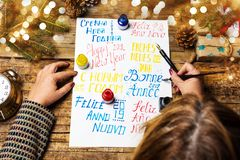 Writing a Happy new year card in various languages stock photos