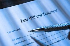Person writing last will and testament Stock Photos