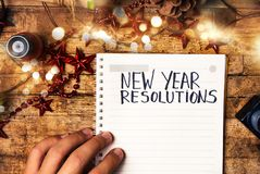 Person writing new year resolutions. First person view stock images