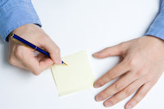 Person writing on paper. Person writing a message on a piece of paper or note Royalty Free Stock Photos