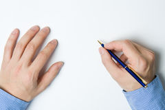 Person writing on paper. Person writing a message on a piece of paper or note Royalty Free Stock Images
