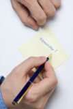 Person writing on paper Royalty Free Stock Photos