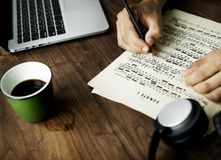 Person Writing on White Printer Paper royalty free stock image