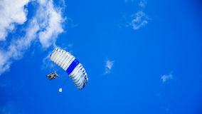 Person in Yellow Suit Flying With the Parachute Under Blue Calm Sky during Daytime Stock Photos