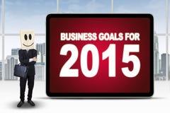 Persona acertada con las metas de negocio para 2015 Foto de archivo libre de regalías