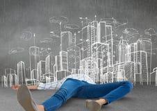 Persona che si trova con l'esaurimento creativo di burnout dai disegni della città Fotografia Stock