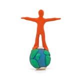 Persona che tiene l'equilibrio del globo Immagini Stock