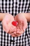 Persona con el corazón Imagenes de archivo