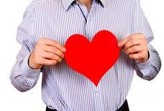 Persona con el corazón rojo Imagenes de archivo