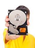 Persona con el disco duro Foto de archivo