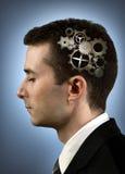 Persona con los engranajes en su cabeza Imagen de archivo libre de regalías
