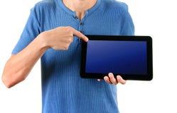Persona con un computer della compressa Fotografia Stock