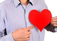 Persona con una forma del corazón Fotos de archivo