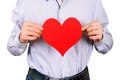Persona con una forma del corazón Imágenes de archivo libres de regalías