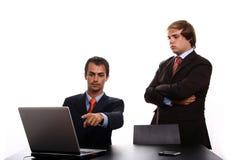 Persona corporativa che per mezzo del computer portatile Immagine Stock