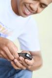 Persona dedita del telefono cellulare Immagini Stock