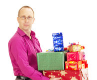 Persona del asunto con muchos regalos Imágenes de archivo libres de regalías