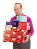 Persona del asunto con muchos regalos Imagenes de archivo