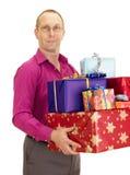 Persona del asunto con muchos regalos Foto de archivo libre de regalías