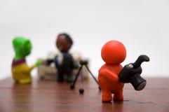 Persona del Plasticine con el hombre de negocios y el extranjero Imagenes de archivo