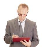 Persona di affari con i appunti Fotografia Stock