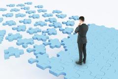 Persona di affari sulla strada di puzzle Immagini Stock Libere da Diritti