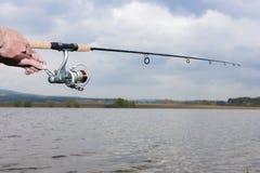 Persona di pesca Fotografie Stock