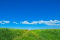 Persona en el campo verde 3 Foto de archivo